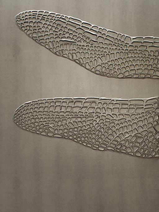 Detail of hand-sculpted dragonfly artwork in steel colour shagreen textured faux leather and matching colour aluminium frame