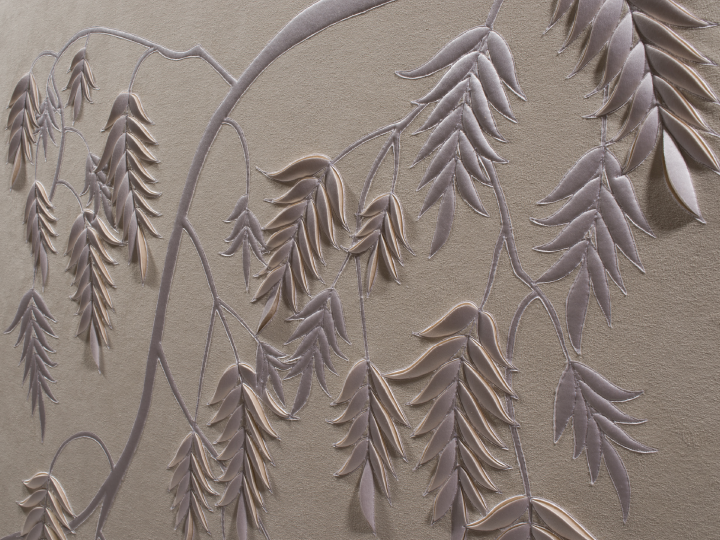 Detail of hand-sculpted white faux suede artwork by Helen Amy Murray with fern design with white silk crepe satin appliqué
